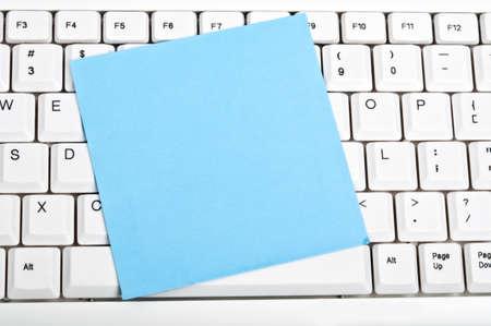 Post-it on an white keyboard photo