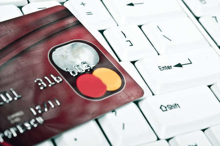 Credit card on an white keyboard Stock Photo - 9253156