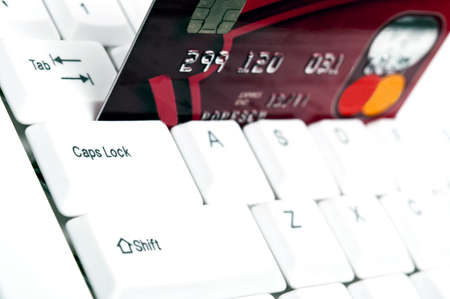 Credit card on an white keyboard Stock Photo - 9252757
