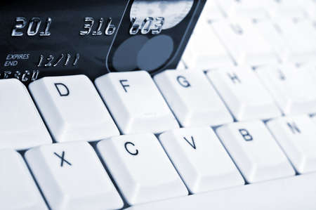 Credit card on an white keyboard Stock Photo - 9253128