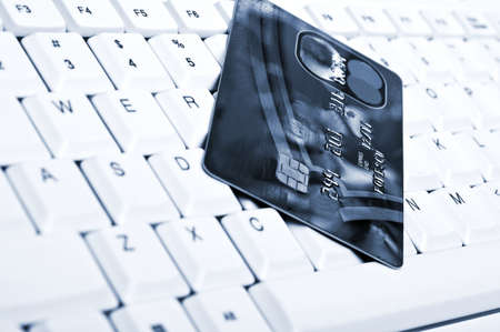 Credit card on an white keyboard Stock Photo - 9253144