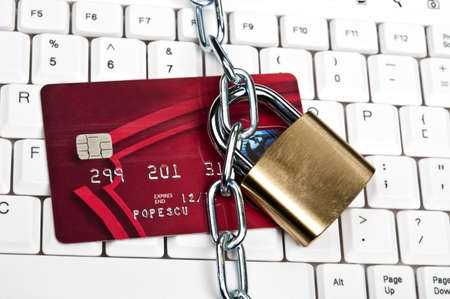 transaction: Creditcard op een witte toetsenbord Stockfoto
