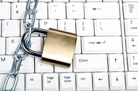 Lock on an white keyboard Stock Photo - 9253149