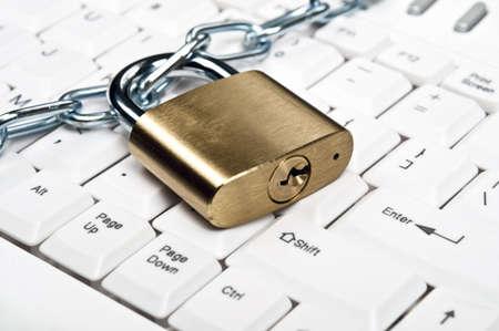 Lock on an white keyboard Stock Photo - 9253030