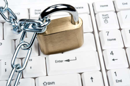 Lock on an white keyboard Stock Photo - 9253033