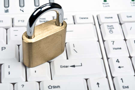 Lock on an white keyboard Stock Photo - 9253118
