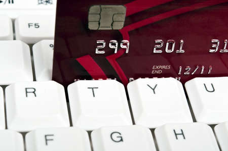 Credit card on an white keyboard Stock Photo - 9253171