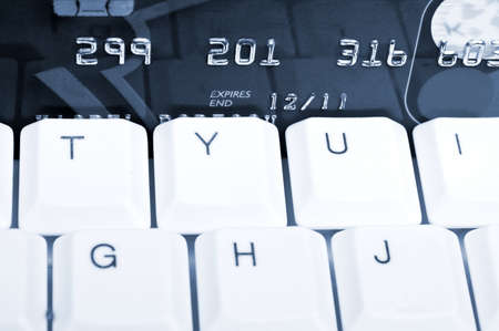 Credit card on an white keyboard Stock Photo - 9253178