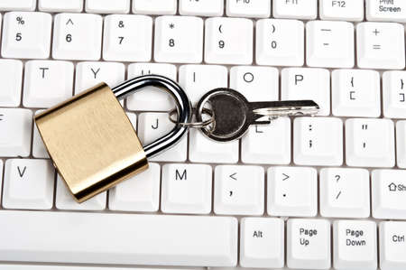 technology transaction: Lock on an white keyboard