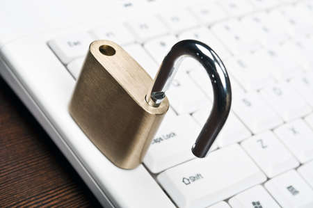 Lock on an white keyboard Stock Photo - 9253018