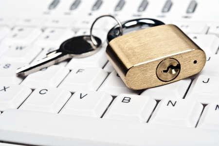 Lock on an white keyboard Stock Photo - 9253057