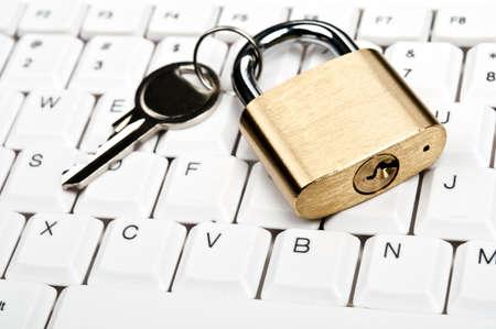 Lock on an white keyboard Stock Photo - 9253122