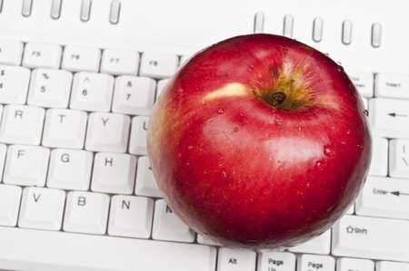Apple on an white keyboard