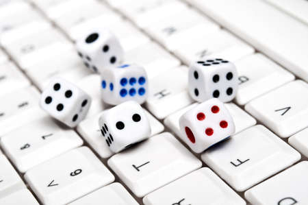 Dice on an white keyboard photo