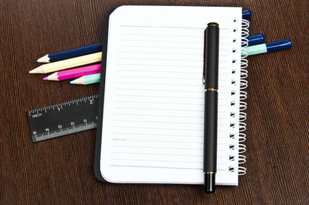 Office supplies and an notebook photo