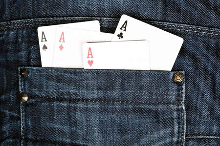 Closeup to jeans pocket with game cards photo