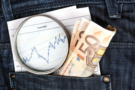 Jeans pocket with magnifying glass and exchange graph photo