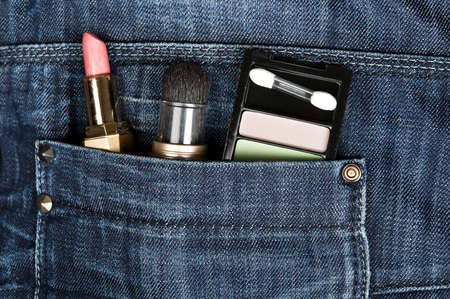 Closeup to jeans pocket with lipstick photo