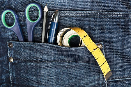 tailor: Closeup to jeans pocket with tailor tools