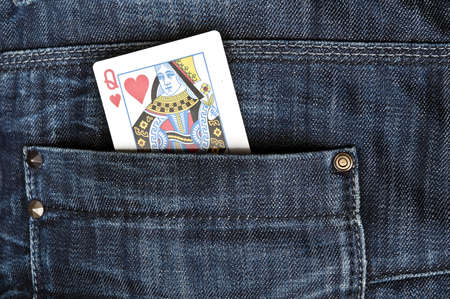 Closeup to jeans pocket with queen game card photo
