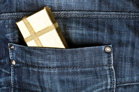 Closeup to jeans pocket with photo