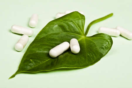 Pills on an green leaf photo