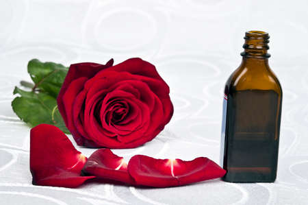 Red rose and essence bottle photo