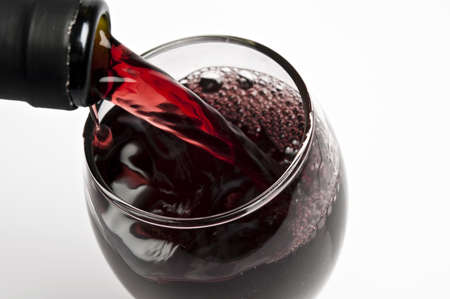 Red wine pouring close up photo
