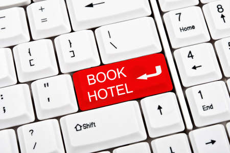 Book hotel key in place of enter key Stock Photo - 9339504