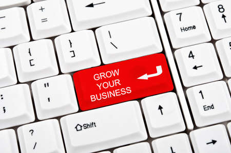 Grow your business key in place of enter key Stock Photo - 9339463