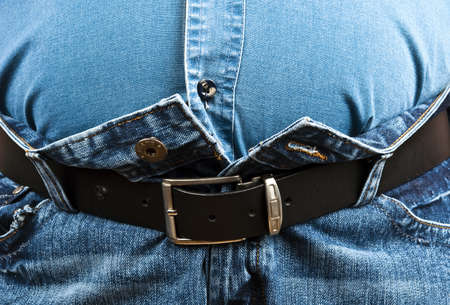 overeating: Fat man cant close jeans