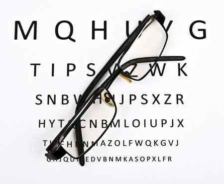 Eye glasses on examination paper Stock Photo - 9345804