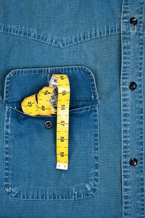 cm: Jeans shirt pocket with cm ruler Stock Photo