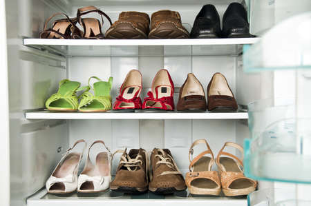 Refrigerator close up with shoes inide photo