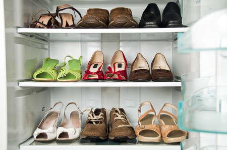 shoe shelf: Refrigerator close up with shoes inide