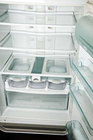 Empty refrigerator shelfs close up  photo