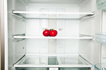 Refrigerator close up with tomatoes photo
