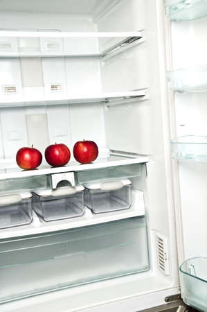 Refrigerator close up with red apple Stock Photo - 9346266