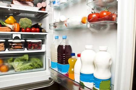 Refrigerator full of food close up photo