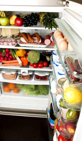 refrigerator with food: Refrigerator full of food close up