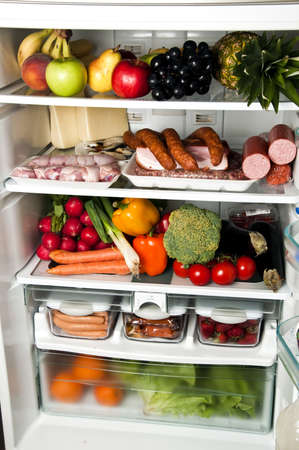Refrigerator full of food close up photo