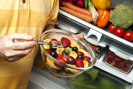 Fruit salad in male hands Stock Photo - 9346377
