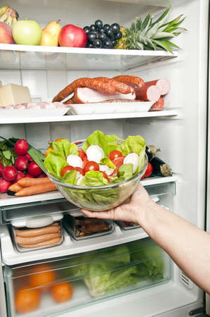 Refrigerator close up with salad photo