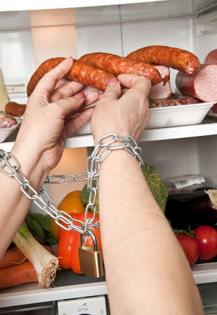 Woman hands locked try to grab sausage photo