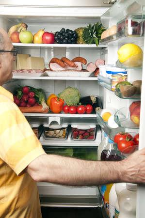 Refrigerator close up with mature man photo