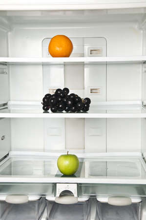 Refrigerator close up with fruits photo