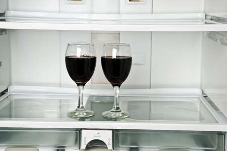 Refrigerator close up with wine glasses photo