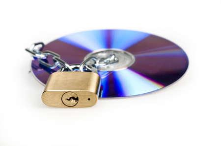 Padlock and cd on white photo