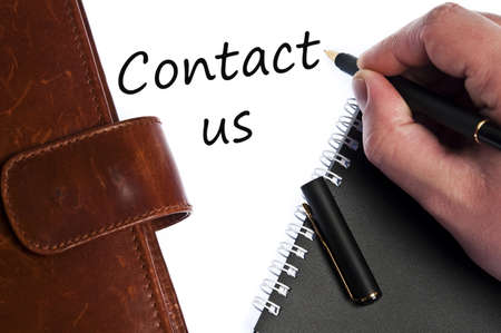 write us: Contact us write by male hand Stock Photo