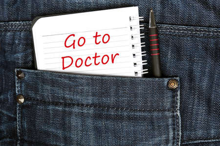 Go to doctor message on notepad photo